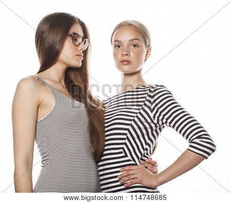two young workers isolated on white, same dresses in strip