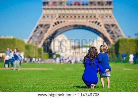 Happy family in Paris background Eiffel on french vacation