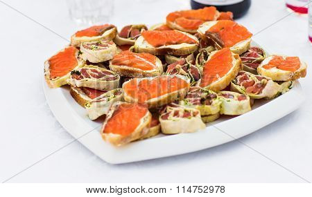 Delicious Appetizer Meat and Fish Canapes. Selective Focus