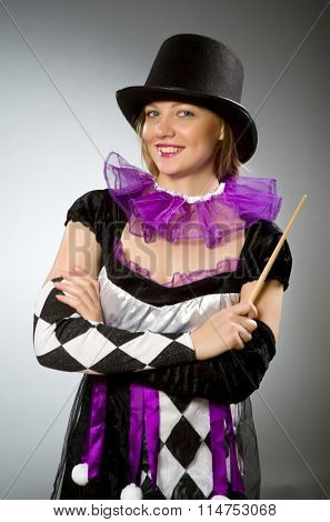 Woman magician doing her tricks with wand