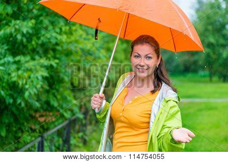 Portrait Of A Girl With An Umbrella In Rainy Weather