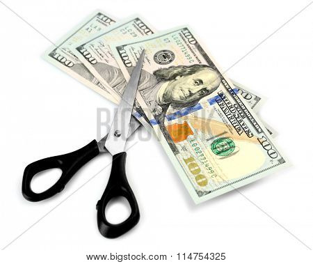 Scissors cut dollar banknotes, isolated on white