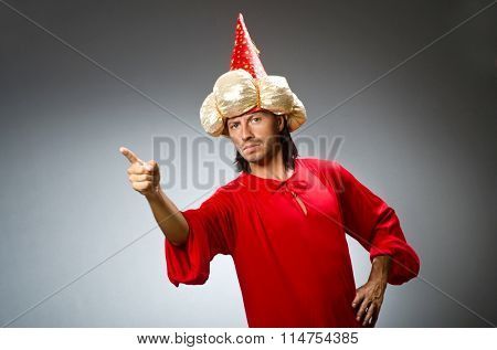Funny wizard wearing red dress