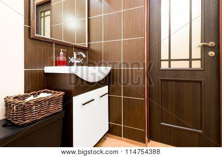 A Bathroom In Dark Tones Decorated Laconically