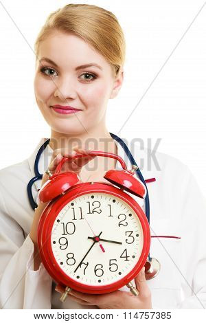 Woman Doctor With Clock Isolated On White