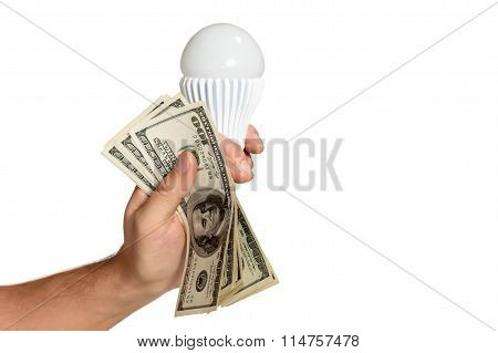 hand with dollars and led lamp