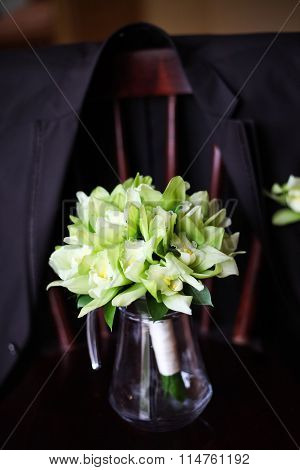 Wedding Bouquet In Green Vase On The Chair