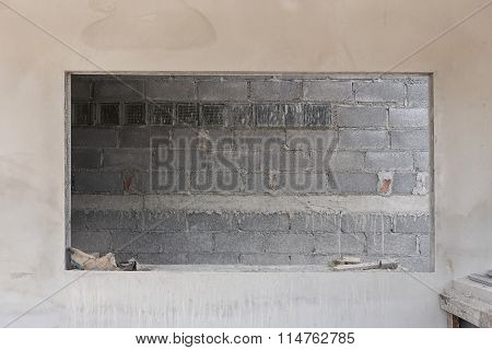 Window On Cement Wall With Brick Wall Background In Construction Building