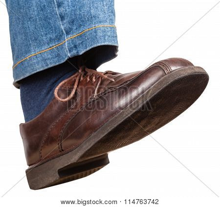 Step Of Male Right Leg In Jeans And Brown Shoe