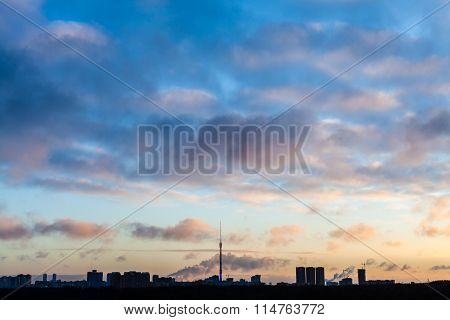Dark Blue Sky Over City In Cold Winter Sunrise