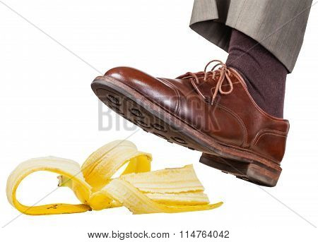 Foot In The Left Brown Shoe Slips On A Banana Peel