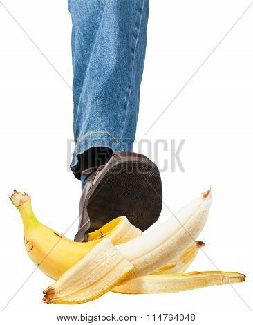Left Leg In Jeans And Shoe Stepping On Banana