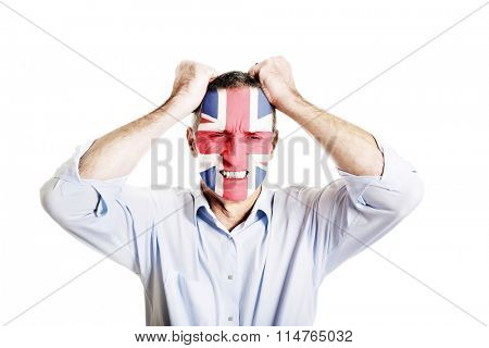 Mature man with Great Britain flag on face.