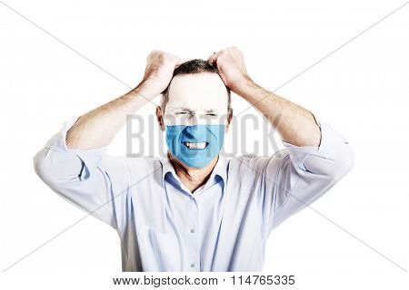 Mature man with San Marino flag on face.