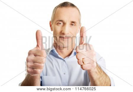 Portrait of mature man gesturing ok sign