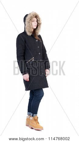 Back view of going  woman in parka. walking young girl. Rear view people collection.  backside view of person.  Isolated over white background. Frozen woman wearing a fur hood out of the frame.