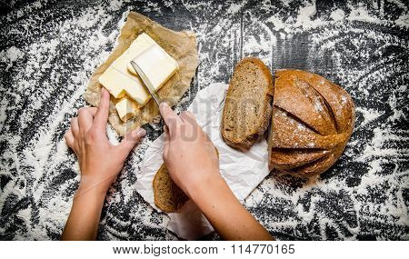 The Buttering Of Bread With Butter On Board With Flour.