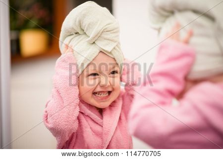 Child with towel on head