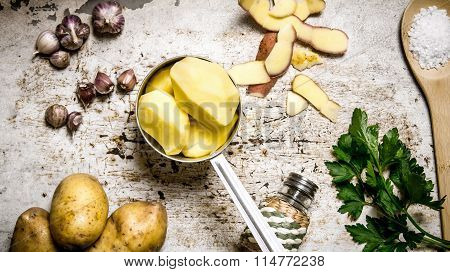 The Concept Of A Peeled Potato In The Pot On The Rustic Background .
