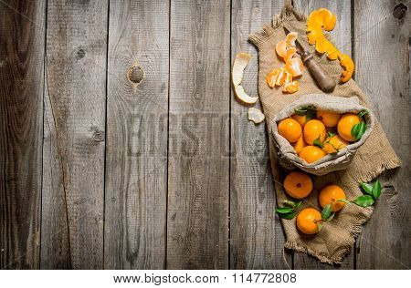 Fragrant Tangerines In An Old Bag With A Knife And Peeled Tangerines.