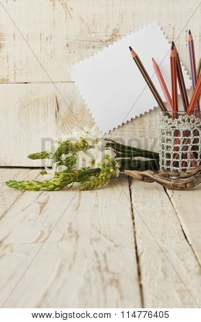 Pencils in the glass and flowers, selective focus