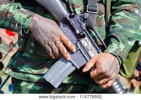 Closeup Male Soldier Hands Holding Machine Gun, Selective Focus On Hand
