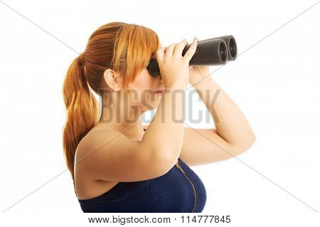 Overweight woman seeking with binocular