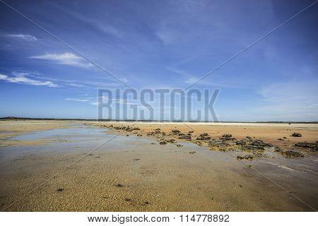 Beach Rocks At Low Tide