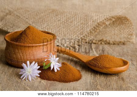 White Chicory Flower And Full Wooden Spoon Of Powder  Instant Chicory On Old Wooden Table