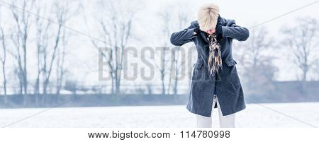 Senior woman with burnout in winter
