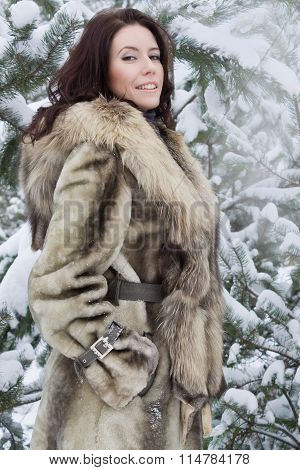 Young Woman In The Winter Forest