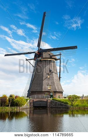 Windmill and water canal in Kinderdijk, Netherlands