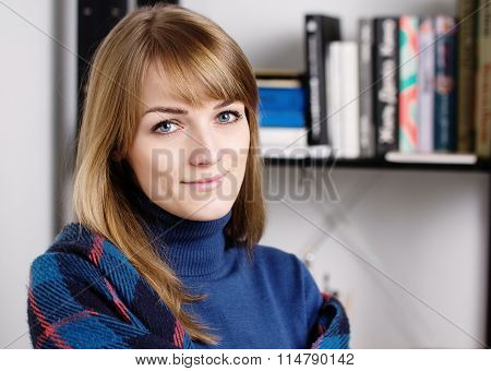 Closeup Of Woman Smiling And Feeling Cozy. Girl Warms.  Home Comfort Concept.