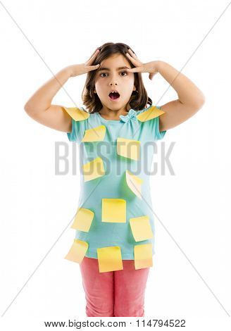 Stressed young girl with yellow notes sticked all over the body