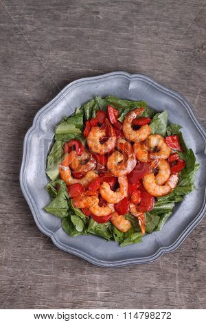 Boiled Shrimp With Red Pepper And Salad On A Gray Background