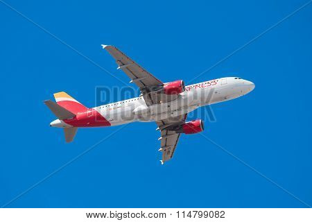 Iberia Airbus 320 is taking off from Tenerife South airport