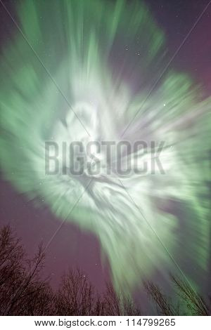 Northern Lights And  Green Aurora Corona In The Cold Winter Sky.