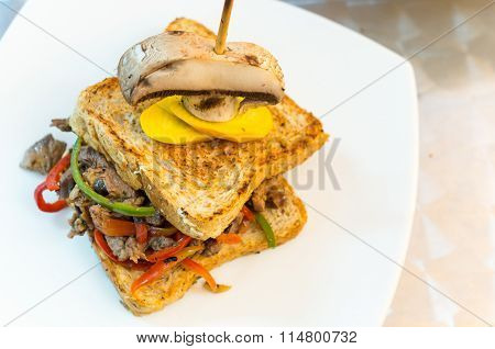 Delicious famous cuban sandwich with perfectly cooked cuts of meat and mixed vegetables between brea