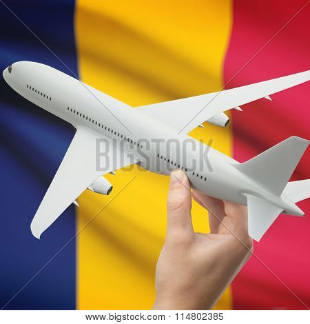Airplane In Hand With Flag On Background - Chad