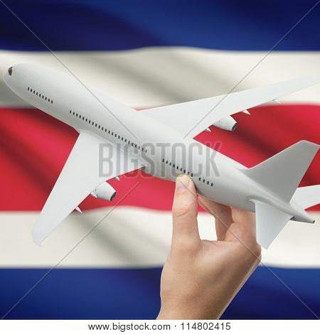 Airplane In Hand With Flag On Background - Costa Rica