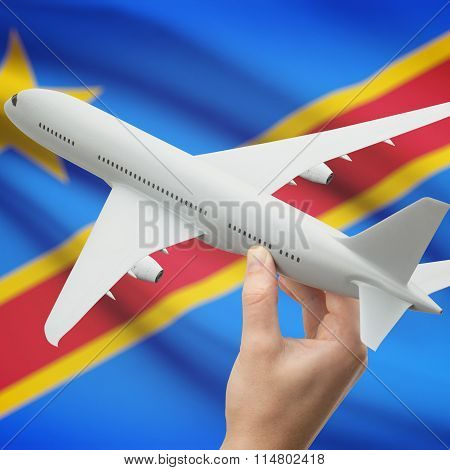 Airplane In Hand With Flag On Background - Congo-kinshasa