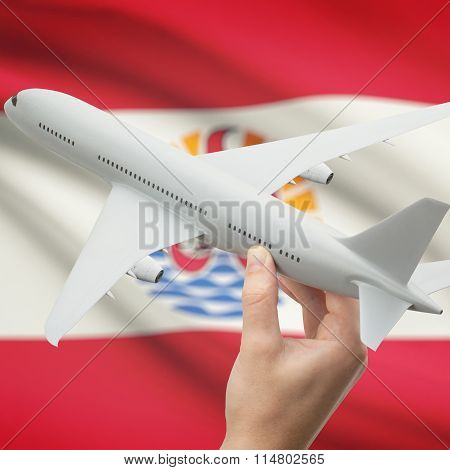 Airplane In Hand With Flag On Background - French Polynesia