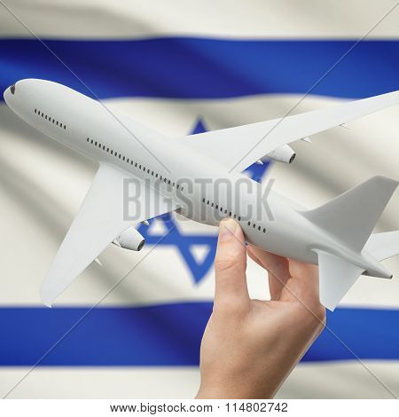 Airplane In Hand With Flag On Background - Israel