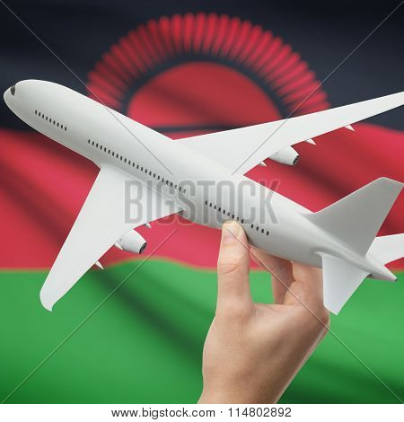 Airplane In Hand With Flag On Background - Malawi