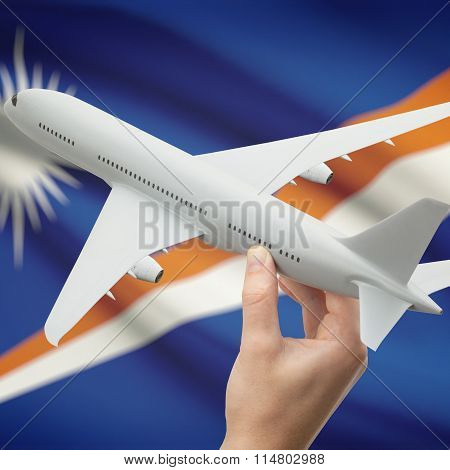 Airplane In Hand With Flag On Background - Marshall Islands