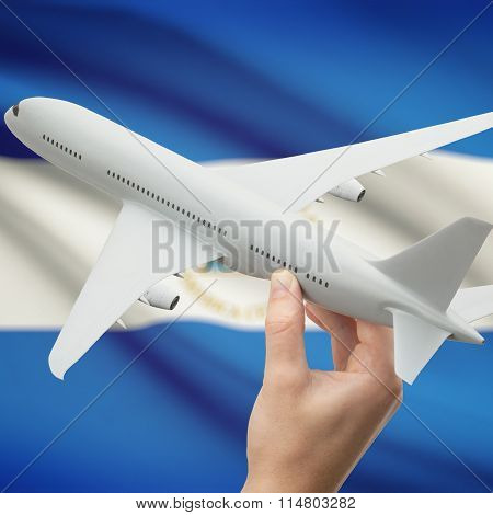 Airplane In Hand With Flag On Background - Nicaragua
