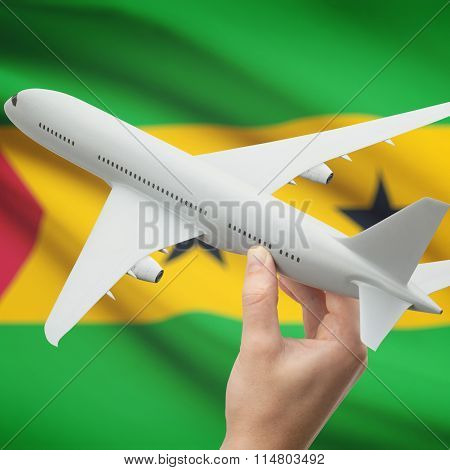 Airplane In Hand With Flag On Background - Sao Tome And Principe