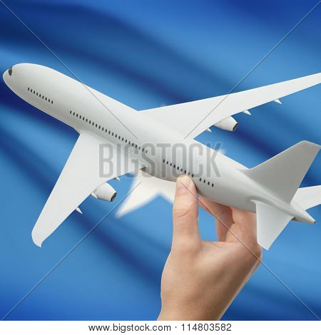Airplane In Hand With Flag On Background - Somalia