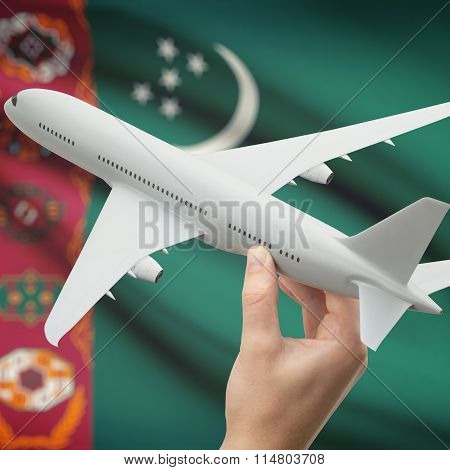 Airplane In Hand With Flag On Background - Turkmenistan