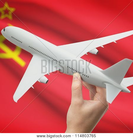 Airplane In Hand With Flag On Background - Ussr - Soviet Union